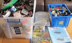 Two huge tubs of Lego including books for over 50 sets