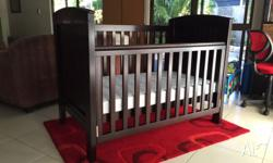 Excellent condition. Walnut colour cot with 2 base
