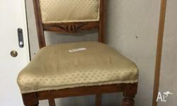 Antique bedroom chair-light coloured wood. Ornate