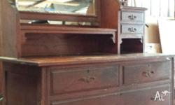 Antique bedroom dresser with mirror. Some markings on