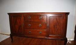 This antique buffet is in excellent condition and great