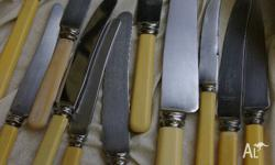 Antique butter knives and one large antique knife, 11