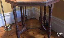 This pretty hall table stands 70cm high and about 75cm