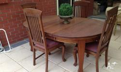 Antique extendable teak dining suite with 4 chairs with