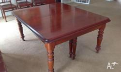 Antique extendable timber dining table. Good condition