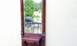 Antique timber hall stand.Is quite old,has nice bevel