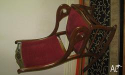 ANTIQUE HARD WOOD ROCKING CHAIR, I WOULD SAY