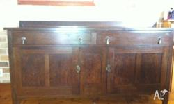 Matching antique oak dining table and sideboard.