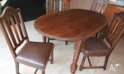 On offer is an Oval Dining Table and 4x Antique