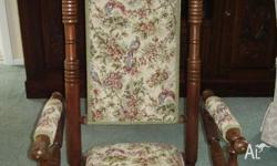 Beautifully upholstered in a tapestry featuring