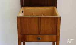 For sale is an antique sewing cabinet. It has a small