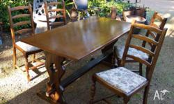 This oak table and four chairs is in an Ercol refectory