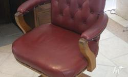 One Swivel Clerk Chair. Oak covered in red leather.