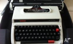 ANTIQUE BROTHER BRAND PORTABLE TYPEWRITER. THIS MACHINE