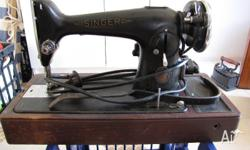 Vintage Singer Sewing Machine for sale. Electric - has