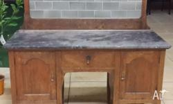 Oak wash stand with marble top & tiled backboard has
