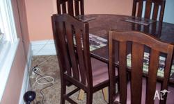 Antique Wooden extension table with 6 chairs in Good