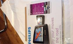 "This Philips 7"" Twin DVD Player is DVD, DVD+/-R,"