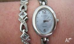 As new - matching womens watch and bracelet set -