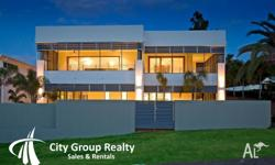 Situated on a 955m2 block, this uniquely designed 3