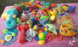 Assorted baby toys including musical toys, teethers,