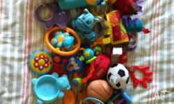 Assorted baby toys, including pram toys, ELC camera and