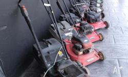 Assorted lawn mowers and gardening equipment, all