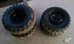 Full set of ATV wheels and tyres removed from a Honda