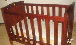 Baby cot in very good condition for sale. Has 2 front