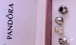 4 Authentic Pandora charms New,and selling 2 have 14kt