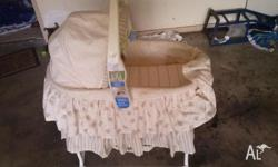 cute bassinet on the handle has a light and vibration