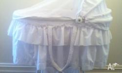 Beautiful white baby bassinet. On castors. In very good