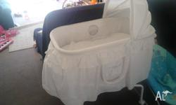 Lovely white bassinet barely used matress included