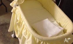 Baby bassinet in very good condition with large storage