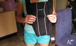 BLACK. INCLUDES BIB FOR BABY CARRIER AND OWNERS