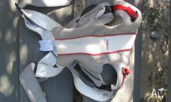 Baby Bjorn carrier . New. Grey with red and white