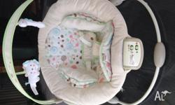 Baby bouncer Plays music and vibrates Removable cover