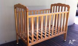 Wooden baby cot is in good condition except for some