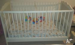 Good condition baby cot. Can be assembled into baby cot