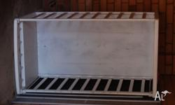 White wooden cot. Good condition. One side of cot can