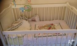 Baby cot and mattress up for sale still in good