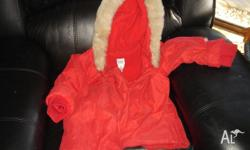 Lovely Baby Gap winter coat with fake fur lined hood.