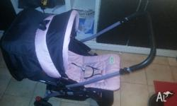 Cute baby girl pram well looked after cup holders ect.
