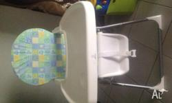 Baby high chair/feeding table for sale. Good condition.