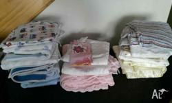 Mixed selection of baby blankets, flannalette sheets