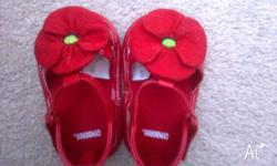 Red baby shoes size 2 to fit roughly 6-12 month old .