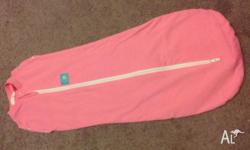 Brand new Pink Ergococoon Baby Swaddle 0-3 months.
