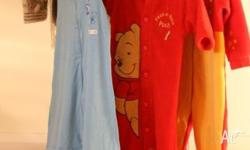 several boys/girls warm all in one wooly sleep suits,