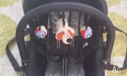 Baby Rocker has detachable hooded cover. Harness &