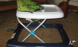 Baby walker in great condition. Folds down flat for